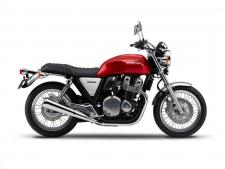 You want proof that a great idea never goes out of style? Then just check out the new 2017 Honda CB1100 EX. Externally, it's pure Honda classic: that red steel tank, the air-cooled transverse-four engine, the brushed aluminum sidecovers, the round headlight, the chromed fenders, the comfortable, upright seating and tubular-steel handlebar. But twist the throttle, and you'll see there's nothing retro about the CB1100 EX's performance. Displacing a full 1140cc, the six-speed overdrive gearbox and electronic fuel injection deliver performance no 1970's classic ever could.