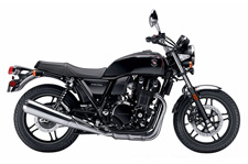 Though the CB1100 pays homage to Honda's long line of capable, reliable and fun street bikes, we wouldn't look to the past without looking forward. This is a modern bike for riders that love to ride. Its1140cc, fuel-injected inline four is powerful and smooth, its chassis and suspension are agile and responsive, and it's comfortable around town or on weekend rides. For 2014, we're offering a Deluxe model with even more features. It's a bike a whole new generation of riders is going to appreciate.