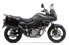 The V-Strom 650 ABS Adventure is another choice in adventure touring. It has striking accessories that include sleek aluminum side cases large enough to fit a full-coverage helmet, a rugged accessory engine bar and an adjustable windscreen. It also has the same improved performance as the original V-Strom 650 ABS. Its 645cc V-Twin engine has improved low-to-mid rpm performance, matched by enhanced fuel economy and environmental performance.