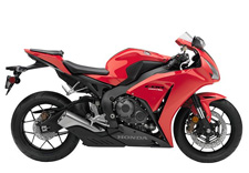 Honda's CBR1000RR is a legend among Superbike riders and the 2015 model is clearly the best CBR1000RR we've ever offered, especially since you can get one with our revolutionary C-ABS. There's no room for second best in this class, and the CBR1000RR is a standout performer both on and off the track. No motorcycle connects rider, machine and road like a sportbike. The immediate acceleration, the chassis that feels like an extension of your own skeleton, the power, the handling—and the bigger the sportbike, the more intense the experience. Honda's CBR1000RR has long been the ultimate Superbike for experienced aficionados, and the 2015 CBR1000RR is really something special. First off, we're celebrating Honda MotoGP rider Marc Marquez's back-to-back World Championships with some special graphics packages on the standard and SP models. Then there's the CBR1000RR ABS version, with the most sophisticated brake package in the class. But here's the biggest news: Track-day enthusiasts need to check out the CBR1000RR SP Repsol Edition version. With fully adjustable Öhlins front and rear suspension, Brembo front brakes and Pirelli Diablo Supercorsa SC premium tires. The SP also includes a special lightweight subframe with solo seat cowl. The SP doesn't stop there, with hand-selected engine parts for weight and balance, including pistons and connecting rods