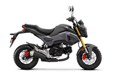 If you—and about three-quarters of the planet—thought the Honda Grom was cool before, check out the new 2017 version! The first thing you'll notice is the new, aggressive bodywork and rad new colors. Then pay some attention to the new headlight—its LED design not only looks fresh, but it works great too. There's a new two-tier seat, a more defined tail section, and a new low-mount muffler design.