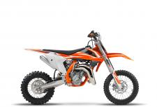 The KTM 65 SX is a fully-fledged piece of sports equipment for young pilots aged around 8- to 12-years-old. This year's top student features a revolutionary WP AER 35 front fork, ultra cool graphics and sets the standard in terms of power, riding dynamics, equipment and craftsmanship. Like its larger counterparts, the KTM 65 SX is truly READY TO RACE for its young competitors.