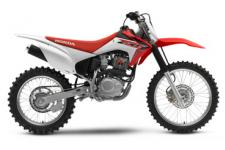 Here's the beauty of Honda's CRF dirtbike lineup: There's something for everyone. Sure, our motocrossers are spectacular machines, but we also know that most of us just want to get out in nature, relax, and enjoy a great trail ride—especially with friends and family. Sound like a great time to you? Then here's your bike—the CRF230F. It's just the right size for most adults or larger teens. It offers plenty of suspension travel for taming the bumps and lots of ground clearance, all without a saddle height that's intimidating. An effortless electric starter and a proven air-cooled Honda four-stroke engine are paragons of convenience and reliability. So grab your riding gear and head for an open trail. We'll take care of the rest.