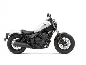 The Honda Rebel 500 is a bike that breaks out from the world of traditional motorcycle style and escapes from the boring boulevard drone. It all starts with a narrow 471cc twin-cylinder engine with plenty of user-friendly power. The blacked-out look, light weight, and low seat height are winners everywhere, and features like Honda�s slip/assist clutch help make riding more enjoyable. And where some cruiser-class bikes are only fun if you ride slow, the Rebel 500 is happy to kick it up a notch. You can even get anti-lock brakes. Plus, for 2021, we�ve added fresh new colors, and our new Rebel 500 ABS SE, a version that comes with a selection of some of our most popular accessories, pre-installed, like our Black Diamond-Stitch Seat, Black Fork Boots and Covers, and a Black Headlight Cowl. So don�t let anyone put you into a cage�discover a new Rebel 500 and escape the ordinary.