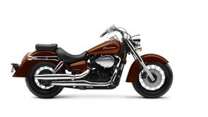 Cruiser class motorcycles are a great choice. You get a relaxed riding position. It's easy to put your feet down at stoplights. Their big, twin cylinder engine makes lots of power down low.  Plus, the Aero is a huge bargain, giving you a big bike ride without the big bike price.  249809
