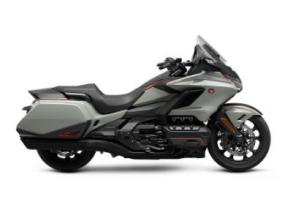 The Honda Gold Wing has always been a spectacular touring bike, ever since the first GL1000 back in 1975. And over the years, our engineers have always stayed true to that vision, but they�ve strived to make the bike better and better. Our 2021 model is a perfect example of that. Refinements abound, but the best parts remain the same. You�ll still have your choice of both manual-transmission models and Gold Wings featuring our exclusive automatic DCT transmission, but this year the trunk is bigger for more road-trip storage, the speakers have a higher 55-watt rating, and the passenger seat on our Tour models is improved. We also freshened up some styling touches, like solid red tail lights and paint choices�check out the grey with orange accent stripe on our no-trunk models! Plus, all Gold Wings are now Android Auto compatible, as well as offering Apple CarPlay�. All in all, a truly great motorcycle gets even better�so your dream ride has everything you�ll need to make memories that last a lifetime.
