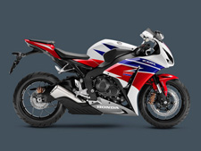 Honda's CBR1000RR is a legend among Superbike riders and the 2015 model is clearly the best CBR1000RR we've ever offered, especially since you can get one with our revolutionary C-ABS. There's no room for second best in this class, and the CBR1000RR is a standout performer both on and off the track. No motorcycle connects rider, machine and road like a sportbike. The immediate acceleration, the chassis that feels like an extension of your own skeleton, the power, the handling—and the bigger the sportbike, the more intense the experience. Honda's CBR1000RR has long been the ultimate Superbike for experienced aficionados, and the 2015 CBR1000RR is really something special. First off, we're celebrating Honda MotoGP rider Marc Marquez's back-to-back World Championships with some special graphics packages on the standard and SP models. Then there's the CBR1000RR ABS version, with the most sophisticated brake package in the class. But here's the biggest news: Track-day enthusiasts need to check out the CBR1000RR SP Repsol Edition version. With fully adjustable Öhlins front and rear suspension, Brembo front brakes and Pirelli Diablo Supercorsa SC premium tires. The SP also includes a special lightweight subframe with solo seat cowl. The SP doesn't stop there, with hand-selected engine parts for weight and balance, including pistons and connecting rods.
