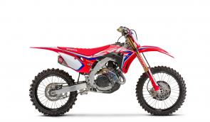 Then there's the limited-production CRF450R Works Edition. The RWE gets all the improvements of the CRF450R plus a special hand-ported cylinder head, black DID DirtStar LT-X rims, a new, exclusive Yoshimura exhaust system with titanium header, titanium nitride-coated lower fork legs and shock shaft, an RK gold chain, special ECU settings, a factory-spec gripper seat, and more.