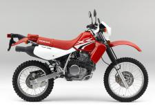 The Honda XR650L is the picture of versatility. Off-road, it dominates the trail with the right combination of power, suspension and durability. And when you're on the road, its light overall weight, electric starter and excellent fuel efficiency make it great for commuting or even long trips.  While the all-new graphics for 2018 will catch the eye, what really sets the XR650L apart is its ultra-tough 644cc overhead cam engine that has torque and power to spare. And because it's air-cooled, it's easy to maintain. Plus, the engine's gear-driven counterbalancer reduces tiring vibrations, so you can ride comfortably for hours on end.  247648